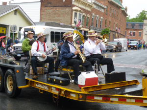 The Sage City Jazz band playing on a parade float