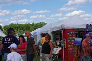 Art and Craft Exhibitors sell handcrafted items at the Southern Vermont Art and Craft Festival in Bennington.